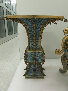 <em>Quadrilateral Trumpet Shaped Vase</em>, late 18th century. Cloisonné enamel on copper alloy, gilt bronze, 24 1/4 in. (61.6 cm). Brooklyn Museum, Gift of Samuel P. Avery, 09.933.3. Creative Commons-BY (Photo: Brooklyn Museum, CUR.09.933.3.jpg)