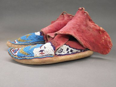 <em>Pair of Moccasins</em>, late 19th-early 20th century. Hide, dye, beads Brooklyn Museum, Purchased with funds given by Herman Stutzer, 10.229.4a-b (Photo: Brooklyn Museum, CUR.10.229.4a-b_view2.jpg)