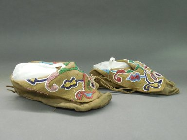 <em>Pair of Moccasins</em>, late 19th-early 20th century. Hide, beads Brooklyn Museum, Purchased with funds given by Herman Stutzer, 10.229.5a-b (Photo: Brooklyn Museum, CUR.10.229.5a-b_view2.jpg)