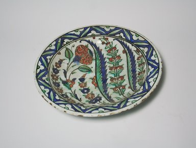 <em>Plate with Low Cylindrical Foot</em>, 17th century. Ceramic, 2 3/8 x 12 1/16 in. (6.1 x 30.6 cm). Brooklyn Museum, Museum Collection Fund, 11.23. Creative Commons-BY (Photo: Brooklyn Museum, CUR.11.23.jpg)