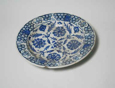 <em>Dish</em>, 18th century. Ceramic; stone paste, painted in blue and turquoise under a transparent colorless glaze, 2 5/16 x 11 7/16 in. (5.8 x 29 cm). Brooklyn Museum, Museum Collection Fund, 11.32. Creative Commons-BY (Photo: Brooklyn Museum, CUR.11.32_top.jpg)