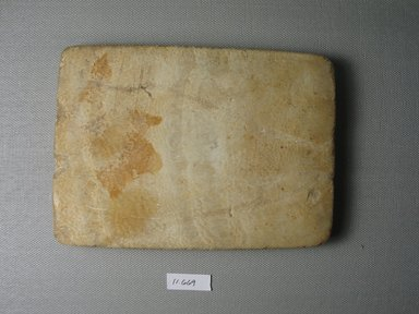 <em>Oblong Plaque with Figure of a Cow</em>. Egyptian alabaster (calcite), 4 1/4 x 6 7/16 x 9/16 in. (10.8 x 16.3 x 1.5 cm). Brooklyn Museum, Museum Collection Fund, 11.669. Creative Commons-BY (Photo: Brooklyn Museum, CUR.11.669_back.jpg)