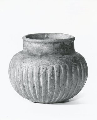 <em>Vase</em>. Faience, 3 × Diam. 2 1/2 in. (7.6 × 6.3 cm). Brooklyn Museum, Museum Collection Fund, 11.676. Creative Commons-BY (Photo: Brooklyn Museum, CUR.11.676_NegA_print_bw.jpg)