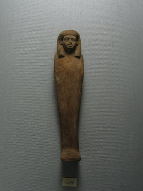 <em>Uninscribed Ushabti</em>. Wood, 6 3/4 x 1 9/16 x 1 1/4 in. (17.2 x 4 x 3.1 cm). Brooklyn Museum, Museum Collection Fund, 11.678. Creative Commons-BY (Photo: Brooklyn Museum, CUR.11.678_view1.jpg)
