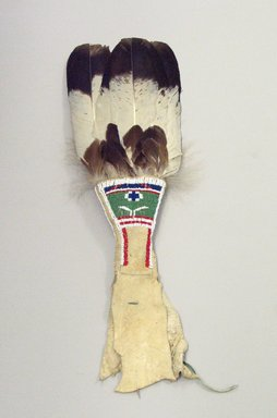 Osage. <em>Fan (iki thadsin)</em>, late 19th-early 20th century. Winter hawk feather, glass beads, wood, wool, hide, pigment, 1 x 7 x 23 1/2 in. (2.5 x 17.8 x 59.7 cm). Brooklyn Museum, Museum Expedition 1911, Museum Collection Fund, 11.694.8977. Creative Commons-BY (Photo: Brooklyn Museum, CUR.11.694.8977_view1.jpg)