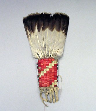 Osage. <em>Fan</em>, late 19th-early 20th century. Hide, eagle feather,porcupine quill,  beads, pigment, 5 1/2 x 14 in. (14 x 35.6 cm). Brooklyn Museum, Museum Expedition 1911, Museum Collection Fund, 11.694.8987. Creative Commons-BY (Photo: Brooklyn Museum, CUR.11.694.8987_view1.jpg)