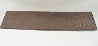 Osage. <em>Cradle Board</em>, late 19th-early 20th century. Walnut, brass tacks, 10 x 41 in. (25.4 x 104.1 cm). Brooklyn Museum, Museum Expedition 1911, Museum Collection Fund, 11.694.9007. Creative Commons-BY (Photo: Brooklyn Museum, CUR.11.694.9007_view1.jpg)