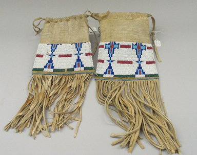 Osage, Cheyenne. <em>Pair of Tobacco Bags</em>, late 19th-early 20th century. Beads, hide, 17 11/16 x 6 1/2in. (45 x 16.5cm). Brooklyn Museum, Museum Expedition 1911, Museum Collection Fund, 11.694.9026. Creative Commons-BY (Photo: Brooklyn Museum, CUR.11.694.9026_view1.jpg)