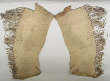 Osage. <em>Pair of Leggings</em>, late 19th-early 20th century. Buckskin, 35 13/16 x 11 in.  (91.0 x 28.0 cm). Brooklyn Museum, Museum Expedition 1911, Museum Collection Fund, 11.694.9049. Creative Commons-BY (Photo: Brooklyn Museum, CUR.11.694.9049.jpg)