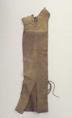 Osage. <em>Tobacco Bag</em>, late 19th-early 20th century. Hide, sinew, 27 3/8 x 7 1/2 in.  (69.5 x 19.0 cm). Brooklyn Museum, Museum Expedition 1911, Museum Collection Fund, 11.694.9051. Creative Commons-BY (Photo: Brooklyn Museum, CUR.11.694.9051_view1.jpg)