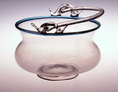<em>Bowl with Handle</em>, 16th century (probably). Glass, height: 4 1/8 in. (bowl without handle). Brooklyn Museum, Purchased by Special Subscription, 11.696.34. Creative Commons-BY (Photo: Brooklyn Museum, CUR.11.696.34.jpg)