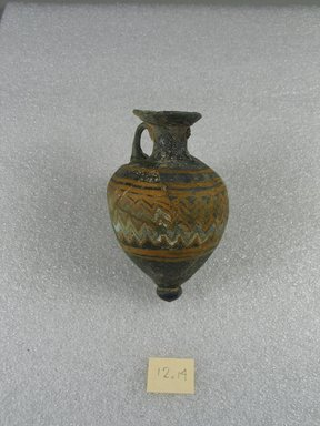 <em>Amphora</em>, 5th century B.C.E. Glass, 3 1/4 x Diam. 1 15/16 in. (8.2 x 5 cm). Brooklyn Museum, Purchased with funds given by Robert B. Woodward, 12.14. Creative Commons-BY (Photo: Brooklyn Museum, CUR.12.14_side1.jpg)