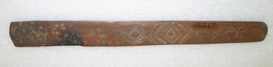 Ainu. <em>Long Rather Wide Prayer Stick</em>. Wood, 1 3/8 x 13 1/16 in. (3.5 x 33.2 cm). Brooklyn Museum, Gift of Herman Stutzer, 12.257. Creative Commons-BY (Photo: Brooklyn Museum, CUR.12.257_bottom.jpg)