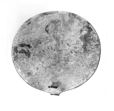 <em>Mirror Disk</em>. Copper, 5 1/16 in. (12.8 cm). Brooklyn Museum, Gift of the Egypt Exploration Society, 12.911.7. Creative Commons-BY (Photo: Brooklyn Museum, CUR.12.911.7_NegB_print_bw.jpg)