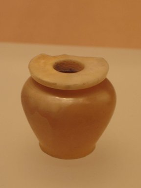 <em>Kohl Jar</em>, ca. 1938-1700 B.C.E. Egyptian alabaster, 2 1/16 x 1 7/8 in. (5.2 x 4.8 cm). Brooklyn Museum, Gift of the Egypt Exploration Fund, 13.1029. Creative Commons-BY (Photo: Brooklyn Museum, CUR.13.1029_mummychamber.jpg)