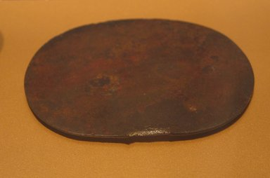 <em>Mirror Disk</em>, ca. 1938-1700 B.C.E. Bronze, 3 11/16 x 4 3/8 in. (9.4 x 11.1 cm). Brooklyn Museum, Gift of the Egypt Exploration Fund, 13.1043. Creative Commons-BY (Photo: Brooklyn Museum, CUR.13.1043_erg2.jpg)