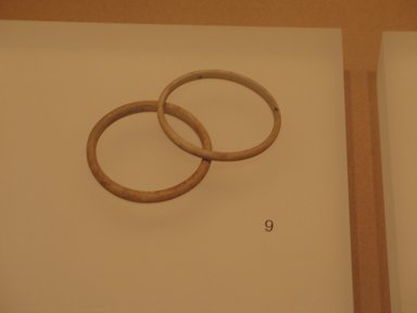 <em>Undecorated Bracelet, One of Pair</em>, ca. 1938-1700 B.C.E. Ivory, 1/4 x 2 1/2 in. (0.6 x 6.3 cm). Brooklyn Museum, Gift of the Egypt Exploration Fund, 13.1046.1. Creative Commons-BY (Photo: , CUR.13.1046.1_13.1046.2_mummychamber.jpg)