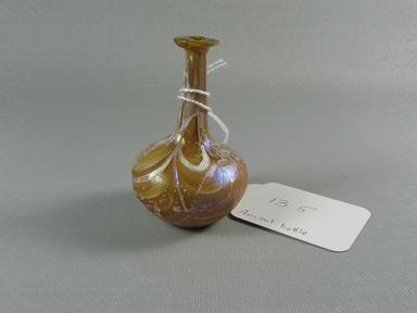 Roman. <em>Bottle</em>, 1st-2nd century C.E. Glass, 3 1/4 x Diam. 2 1/8 in. (8.2 x 5.4 cm). Brooklyn Museum, Gift of Robert B. Woodward, 13.5. Creative Commons-BY (Photo: Brooklyn Museum, CUR.13.5.jpg)