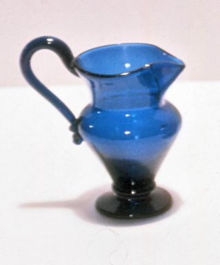 <em>Blue Glass Pitcher</em>, ca. 1750-1810. Glass, 4 x 2 1/2 in. (10.2 x 6.4 cm). Brooklyn Museum, Purchased by Special Subscription and Museum Collection Fund, 13.957. Creative Commons-BY (Photo: Brooklyn Museum, CUR.13.957.jpg)