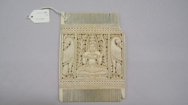<em>Double-sided Comb</em>. Ivory, 6 1/4 x 4 1/2 in. (15.9 x 11.4 cm). Brooklyn Museum, Bequest of Robert B. Woodward, 14.458. Creative Commons-BY (Photo: , CUR.14.458.jpg)