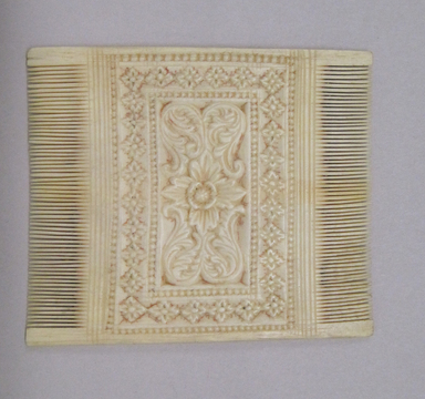 <em>Double-sided Comb</em>. Ivory, 3 7/8 x 3 3/16 in. (9.8 x 8.1 cm). Brooklyn Museum, Bequest of Robert B. Woodward, 14.459. Creative Commons-BY (Photo: , CUR.14.459.jpg)