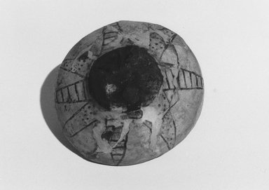 <em>Bowl with Lotus Design</em>, ca. 1479-1400 B.C.E. Faience, 1 1/4 × Diam. 4 1/8 in. (3.2 × 10.5 cm). Brooklyn Museum, Gift of the Egypt Exploration Fund, 14.610. Creative Commons-BY (Photo: Brooklyn Museum, CUR.14.610_NegID_L1007_17_print_bw.jpg)
