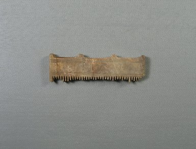 <em>Upper Portion of Comb</em>, ca. 1539-1292 B.C.E. Ivory, 1 3/4 x 3/16 x 3 11/16 in. (4.5 x 0.6 x 9.3 cm). Brooklyn Museum, Gift of the Egypt Exploration Fund, 14.636. Creative Commons-BY (Photo: Brooklyn Museum, CUR.14.636_view1.jpg)