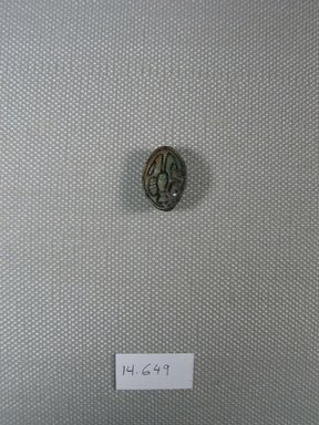 <em>Cowroid Amulet</em>, ca. 1539-1292 B.C.E. Steatite, glaze, 3/16 x 1/2 x 11/16 in. (0.5 x 1.2 x 1.7 cm). Brooklyn Museum, Gift of the Egypt Exploration Fund, 14.649. Creative Commons-BY (Photo: Brooklyn Museum, CUR.14.649_view1.jpg)