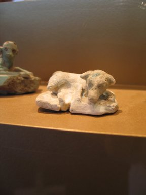 <em>Reclining Dog</em>, ca. 1938-1700 B.C.E. Faience, 13/16 x 1 15/16 x 1 1/2 in. (2 x 4.9 x 3.8 cm). Brooklyn Museum, Museum Collection Fund, 14.659. Creative Commons-BY (Photo: Brooklyn Museum, CUR.14.659_view2_erg2.jpg)