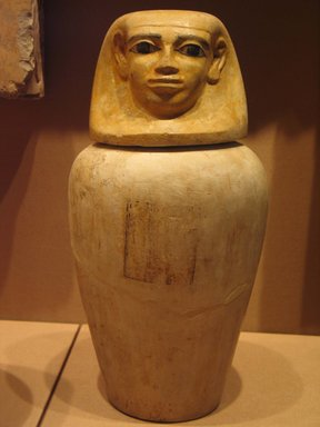 <em>Canopic Jar and Cover of Lady Senebtisi</em>, ca. 1938-1759 B.C.E. Limestone, pigment, 15 1/2 x 8 1/2 in. (39.4 x 21.6 cm). Brooklyn Museum, Museum Collection Fund, 14.662a-b. Creative Commons-BY (Photo: Brooklyn Museum, CUR.14.662a-b_mummychamber.jpg)