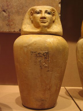 <em>Canopic Jar of Lady Senebtisi</em>, ca. 1938-1759 B.C.E. Limestone, pigment, 15 9/16 in. (39.5 cm). Brooklyn Museum, Museum Collection Fund, 14.663a-b. Creative Commons-BY (Photo: Brooklyn Museum, CUR.14.663a-b_mummychamber.jpg)