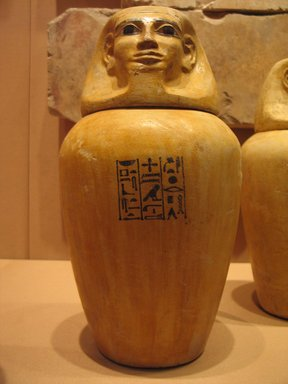 <em>Canopic Jar of Lady Senebtisi</em>, ca. 1938-1759 B.C.E. Limestone, pigment, 10 1/2 x 8 in. (26.7 x 20.3 cm). Brooklyn Museum, Museum Collection Fund, 14.664a-b. Creative Commons-BY (Photo: Brooklyn Museum, CUR.14.664a-b_mummychamber.jpg)