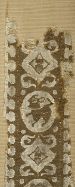 Coptic. <em>Band Fragment with Animal and Geometric Decoration</em>, 8th century C.E. Flax, wool, 14 1/2 x 3 1/8 in. (36.8 x 7.9 cm). Brooklyn Museum, Gift of the Egypt Exploration Fund, 15.428. Creative Commons-BY (Photo: Brooklyn Museum (in collaboration with Index of Christian Art, Princeton University), CUR.15.428_detail01_ICA.jpg)