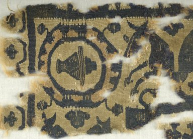 Coptic. <em>Square Fragment with Animal and Potted  Botanical Decorations</em>, 5th-6th century C.E. Wool, 9 x 4 in. (22.9 x 10.2 cm). Brooklyn Museum, Gift of the Egypt Exploration Fund, 15.435. Creative Commons-BY (Photo: Brooklyn Museum (in collaboration with Index of Christian Art, Princeton University), CUR.15.435_detail01_ICA.jpg)