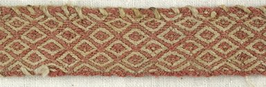 Coptic. <em>Band Fragment with Lozenge Decoration</em>, 5th-6th century C.E. Linen, wool, 3/4 x 8 in. (1.9 x 20.3 cm). Brooklyn Museum, Gift of the Egypt Exploration Fund, 15.445. Creative Commons-BY (Photo: Brooklyn Museum (in collaboration with Index of Christian Art, Princeton University), CUR.15.445_detail01_ICA.jpg)