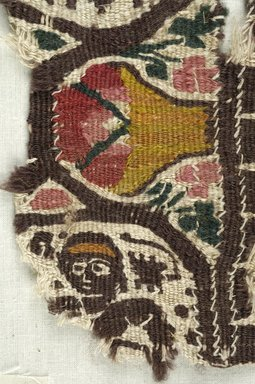 Coptic. <em>Fragment with Figural and Potted Botanical Decoration</em>, 5th century C.E. Flax, wool, 5 x 8 in. (12.7 x 20.3 cm). Brooklyn Museum, Gift of the Egypt Exploration Fund, 15.446. Creative Commons-BY (Photo: Brooklyn Museum (in collaboration with Index of Christian Art, Princeton University), CUR.15.446_detail01_ICA.jpg)