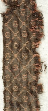 Coptic. <em>Fragment with Lozenge Decoration</em>, 5th-6th century C.E. Wool, 15.449a: 1 3/4 x 16 9/16 in. (4.5 x 42 cm). Brooklyn Museum, Gift of the Egypt Exploration Fund, 15.449a. Creative Commons-BY (Photo: Brooklyn Museum (in collaboration with Index of Christian Art, Princeton University), CUR.15.449A_detail01_ICA.jpg)