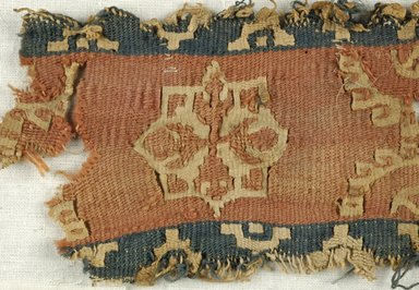 Coptic. <em>Band Fragment with Medallion and Botanical Decoration</em>, 5th-6th century C.E. Flax, wool, 2 9/16 x 6 1/8 in. (6.5 x 15.5 cm). Brooklyn Museum, Gift of the Egypt Exploration Fund, 15.450a. Creative Commons-BY (Photo: Brooklyn Museum (in collaboration with Index of Christian Art, Princeton University), CUR.15.450A_detail01_ICA.jpg)