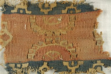 Coptic. <em>Band Fragment with Medallion and Botanical Decoration</em>, 5th-6th century C.E. Flax, wool, 2 9/16 x 3 3/4 in. (6.5 x 9.5 cm). Brooklyn Museum, Gift of the Egypt Exploration Fund, 15.450b. Creative Commons-BY (Photo: Brooklyn Museum (in collaboration with Index of Christian Art, Princeton University), CUR.15.450B_detail01_ICA.jpg)