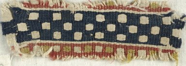 Coptic. <em>Band Fragment with Checkered Decoration</em>, 5th-6th century C.E. Flax, wool, 1 1/2 x 4 in. (3.8 x 10.2 cm). Brooklyn Museum, Gift of the Egypt Exploration Fund, 15.451b. Creative Commons-BY (Photo: Brooklyn Museum (in collaboration with Index of Christian Art, Princeton University), CUR.15.451B_ICA.jpg)