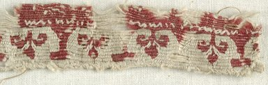 Coptic. <em>Band Fragment with Botanical Decoration</em>. Flax, wool, 1 x 6 in. (2.5 x 15.2 cm). Brooklyn Museum, Gift of the Egypt Exploration Fund, 15.451f. Creative Commons-BY (Photo: Brooklyn Museum (in collaboration with Index of Christian Art, Princeton University), CUR.15.451F_detail01_ICA.jpg)