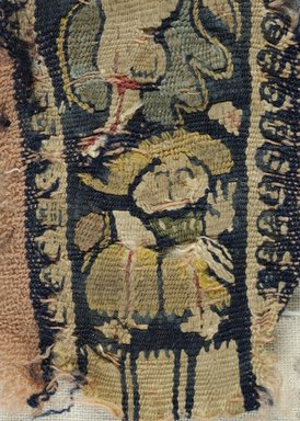 Coptic. <em>Fragment with Figural Decorations</em>, 6th century C.E. Linen, wool, 1 3/4 x 3 3/8 in. (4.5 x 8.5 cm). Brooklyn Museum, Gift of the Egypt Exploration Fund, 15.458. Creative Commons-BY (Photo: Brooklyn Museum (in collaboration with Index of Christian Art, Princeton University), CUR.15.458_detail01_ICA.jpg)