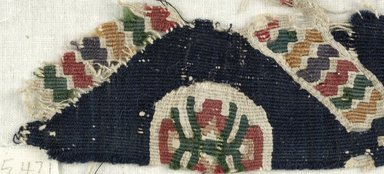 Coptic. <em>Band Fragment with Geometric and Botanical Decorations</em>, 6th century C.E (possibly). Flax, wool, 1 3/4 x 9 7/16 in. (4.5 x 24 cm). Brooklyn Museum, Gift of the Egypt Exploration Fund, 15.471. Creative Commons-BY (Photo: Brooklyn Museum (in collaboration with Index of Christian Art, Princeton University), CUR.15.471_detail01_ICA.jpg)