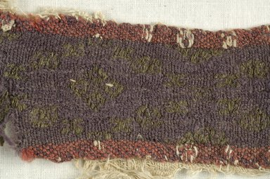 Coptic. <em>Strip Fragment with Lozenge Decorations</em>, 6th century C.E. Flax, wool, 5 1/2 x 9 1/2 in. (14 x 24.1 cm). Brooklyn Museum, Gift of the Egypt Exploration Fund, 15.473. Creative Commons-BY (Photo: Brooklyn Museum (in collaboration with Index of Christian Art, Princeton University), CUR.15.473_detail01_ICA.jpg)