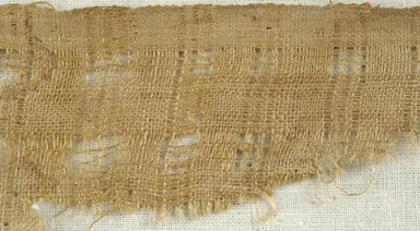 Coptic. <em>Fragment of Plain Cloth Weave</em>, 5th-6th century C.E. Flax, wool, 2 1/2 x 9 in. (6.4 x 22.9 cm). Brooklyn Museum, Gift of the Egypt Exploration Fund, 15.474a. Creative Commons-BY (Photo: Brooklyn Museum (in collaboration with Index of Christian Art, Princeton University), CUR.15.474A_detail01_ICA.jpg)