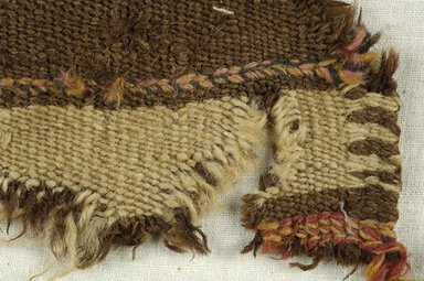 Coptic. <em>Fragment of Tabby Weave</em>, 5th-6th century C.E. Wool, 2 x 5 in. (5.1 x 12.7 cm). Brooklyn Museum, Gift of the Egypt Exploration Fund, 15.475x. Creative Commons-BY (Photo: Brooklyn Museum (in collaboration with Index of Christian Art, Princeton University), CUR.15.475X_detail01_ICA.jpg)