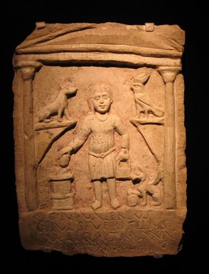 <em>Funerary Stela of C. Julius Valerius</em>, 3rd century C.E. Limestone, pigment, 14 3/16 x 10 1/16 x 2 3/16 in. (36 x 25.5 x 5.5 cm). Brooklyn Museum, Gift of Evangeline Wilbour Blashfield, Theodora Wilbour, and Victor Wilbour honoring the wishes of their mother, Charlotte Beebe Wilbour, as a memorial to their father, Charles Edwin Wilbour, 16.105. Creative Commons-BY (Photo: Brooklyn Museum, CUR.16.105_unearthing_coptic.jpg)