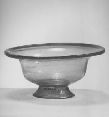 Egypto-Roman. <em>Bowl</em>, 4th century C.E. Glass, 3 x Diam. 5 7/8 in. (7.6 x 15 cm). Brooklyn Museum, Gift of Evangeline Wilbour Blashfield, Theodora Wilbour, and Victor Wilbour honoring the wishes of their mother, Charlotte Beebe Wilbour, as a memorial to their father, Charles Edwin Wilbour, 16.108.10. Creative Commons-BY (Photo: Brooklyn Museum, CUR.16.108.10_NegA_print_bw.jpg)
