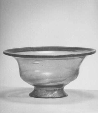 Egypto-Roman. <em>Bowl</em>, 4th century C.E. Glass, 3 1/16 x Diam. 6 1/16 in. (7.7 x 15.4 cm). Brooklyn Museum, Gift of Evangeline Wilbour Blashfield, Theodora Wilbour, and Victor Wilbour honoring the wishes of their mother, Charlotte Beebe Wilbour, as a memorial to their father, Charles Edwin Wilbour, 16.108.13. Creative Commons-BY (Photo: Brooklyn Museum, CUR.16.108.13_NegA_print_bw.jpg)