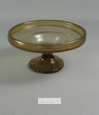 Egypto-Roman. <em>Bowl</em>, 4th century C.E. Glass, 2 1/16 x Diam. 4 3/16 in. (5.2 x 10.7 cm). Brooklyn Museum, Gift of Evangeline Wilbour Blashfield, Theodora Wilbour, and Victor Wilbour honoring the wishes of their mother, Charlotte Beebe Wilbour, as a memorial to their father, Charles Edwin Wilbour, 16.108.19. Creative Commons-BY (Photo: Brooklyn Museum, CUR.16.108.19_view1.jpg)